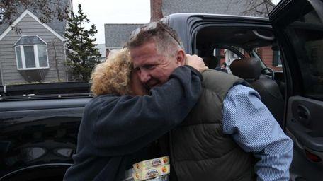 Bruce Casagrande, right, gets a hug from Estelle
