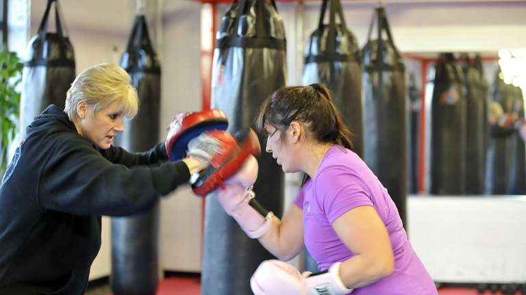 Jasmin Emouna, right, works out with trainer Laurette