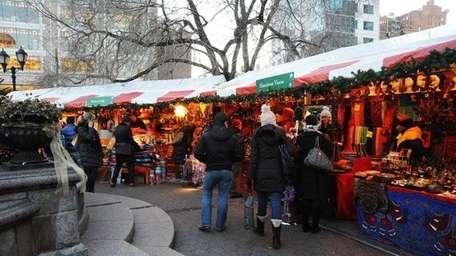Shoppers walk through a previous Union Square Holiday