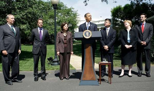 President Barack Obama, center, with his economic team