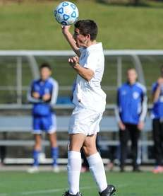 East Hampton's Nicholas West heads the ball during