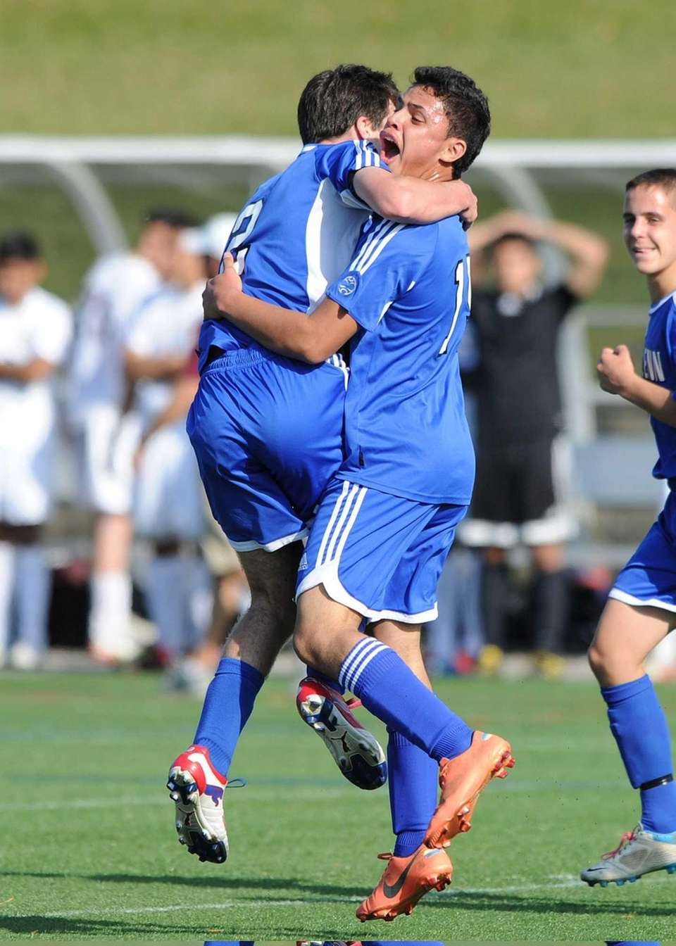 Glenn's Christian Molina (right) celebrates his first-half goal