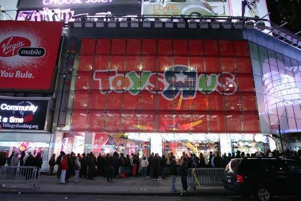 Shoppers wait outside Toys quot;Rquot; Us at Times