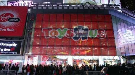 Shoppers wait outside Toys