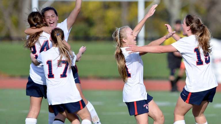 Southside High School girls soccer players celebrate their