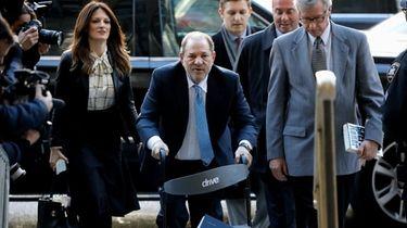 Harvey Weinstein, center, arrives with his attorney Donna