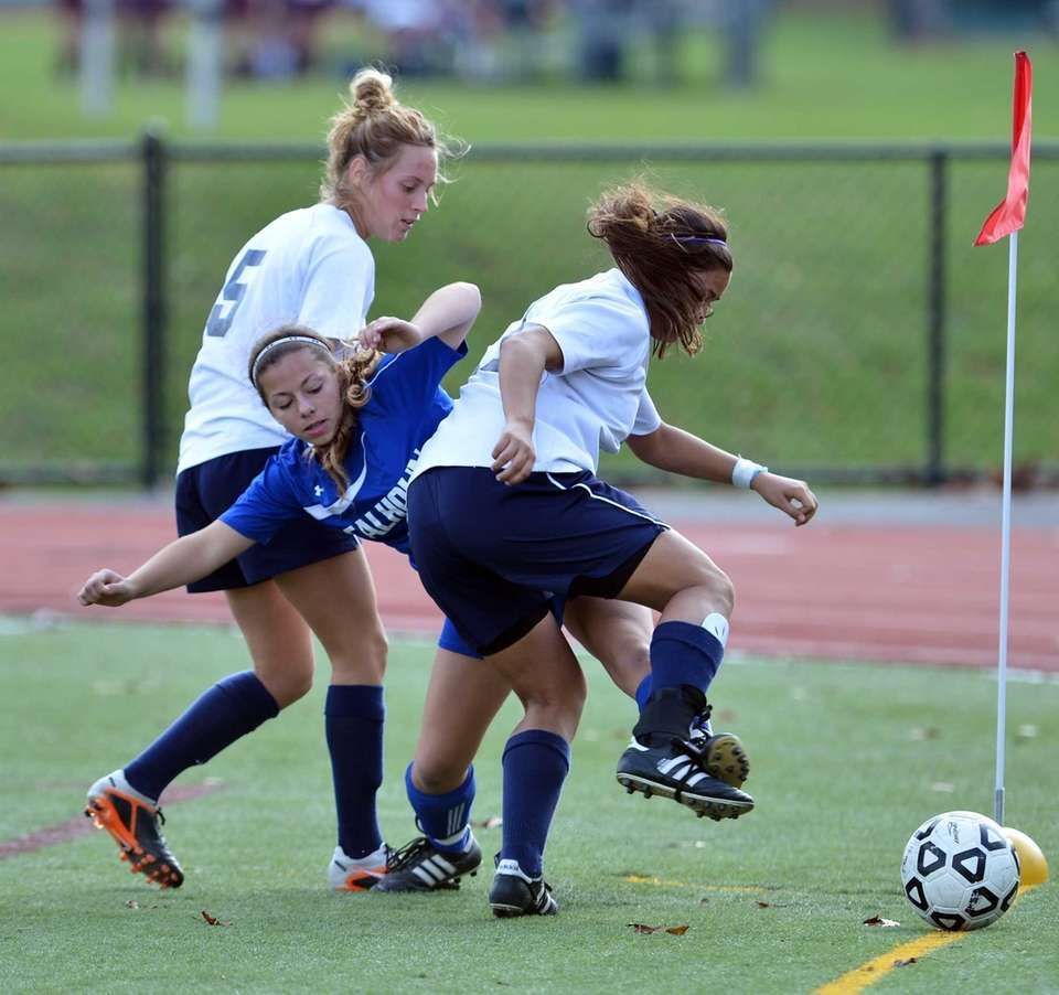 Massapequa's Jaclyn DiMartino, and Tori Maley battle with