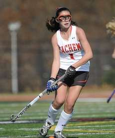 Sachem East's Katie Trombetta looks to pass against