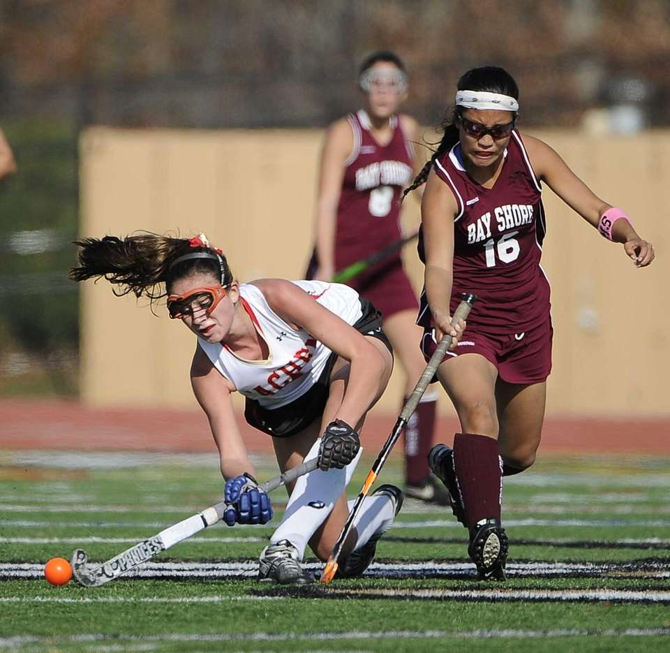 Sachem East's Katie Trombetta crouches low to pass