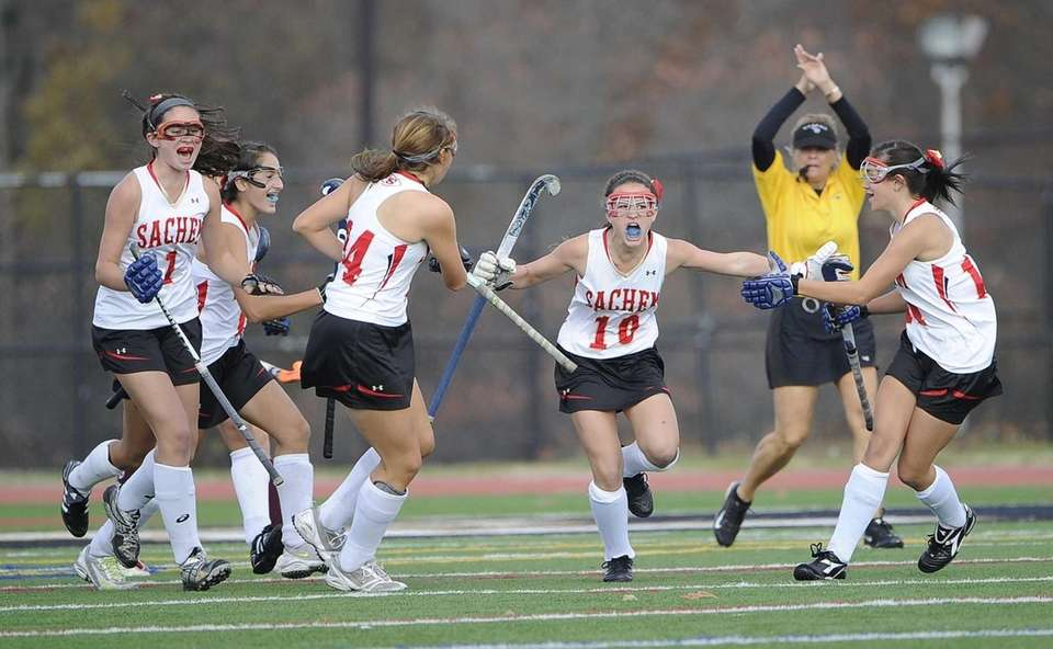 Sachem East's Cara Trombretta reacts with her teammates