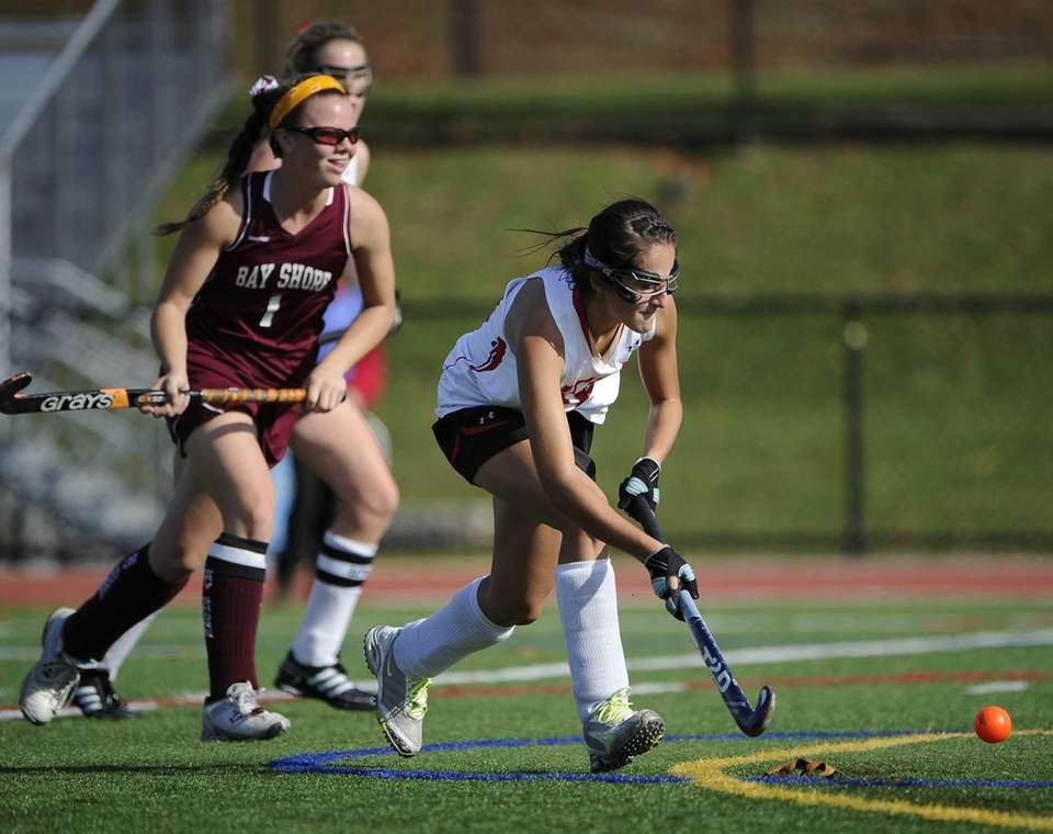 Sachem East's Katie Shanahan moves to shoot and