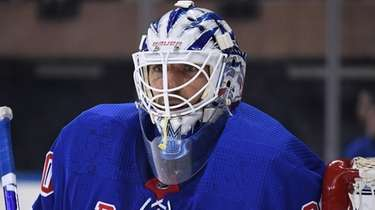 Rangers goaltender Henrik Lundqvist protects the net against
