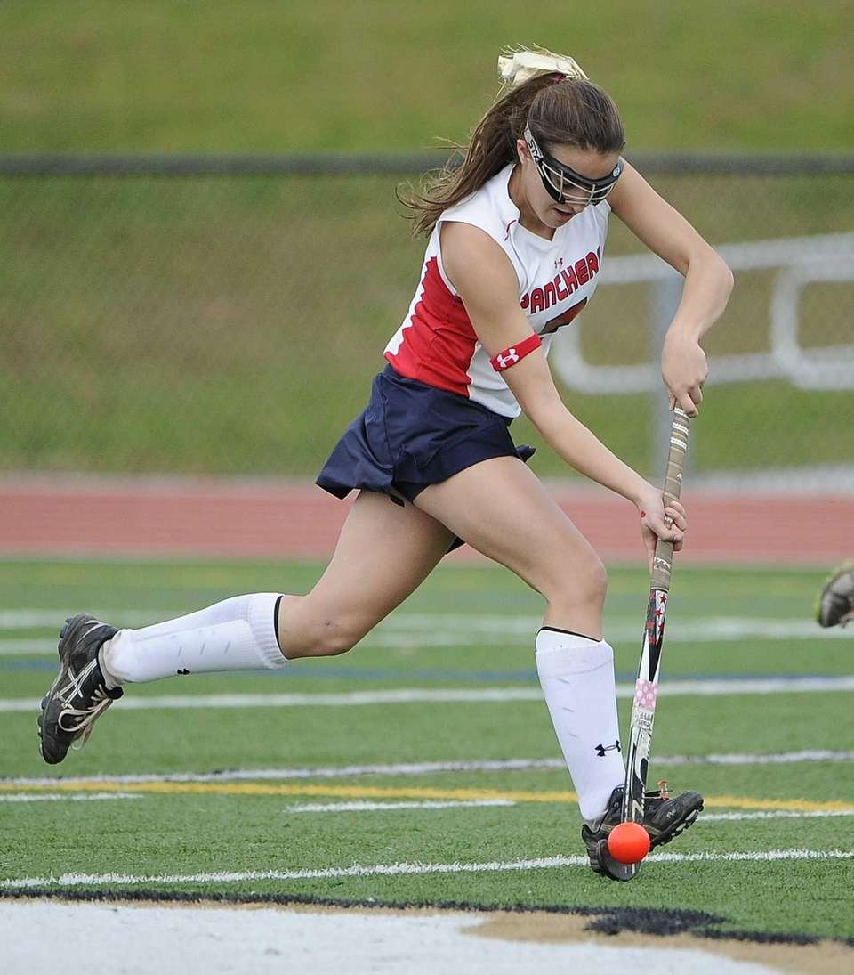 Miller Place's Ally Hutzler drives the ball against