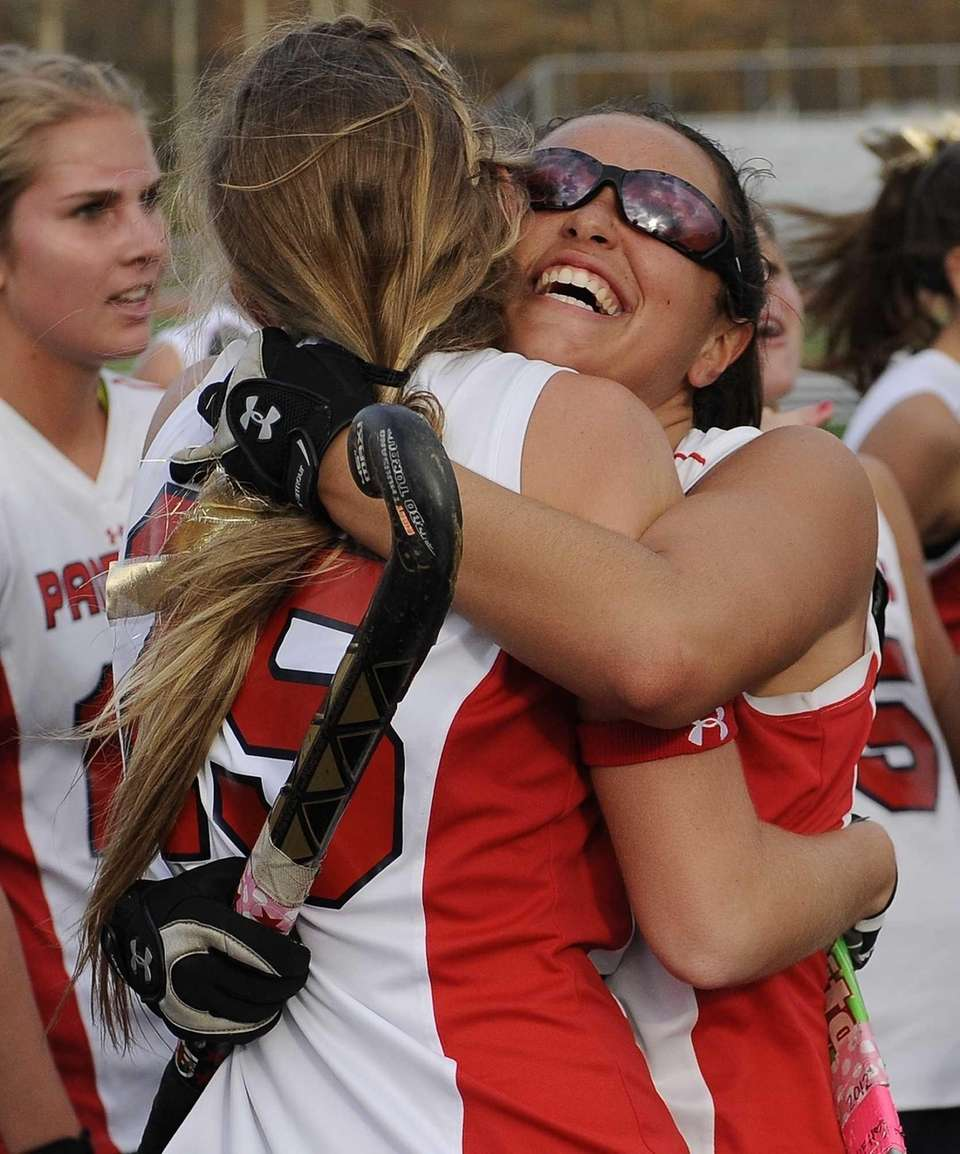 Miller Place's Tiana Parrella, facing, hugs Mandy Boccio