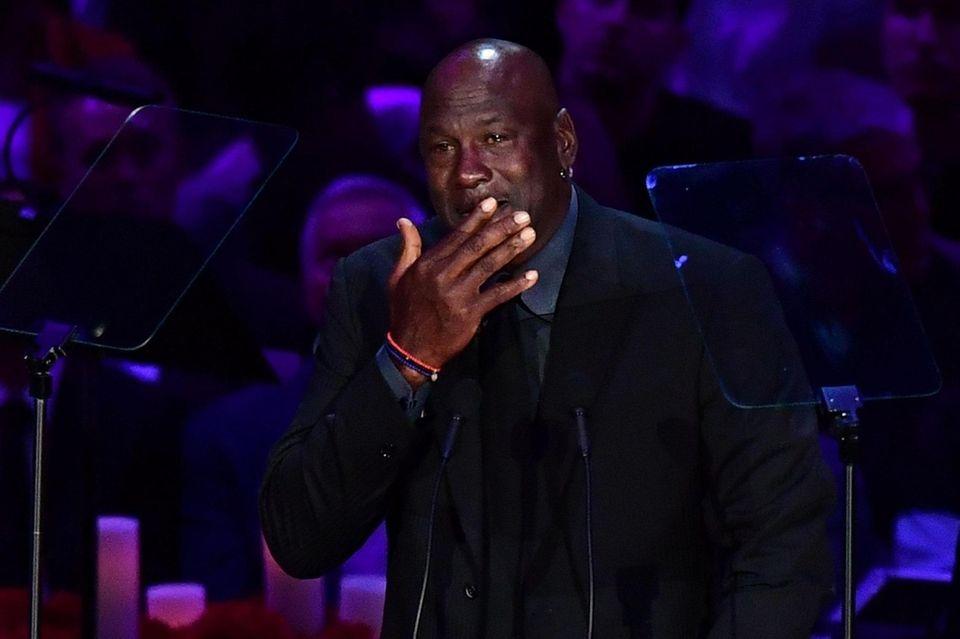 Retired US basketball player Michael Jordan cries as