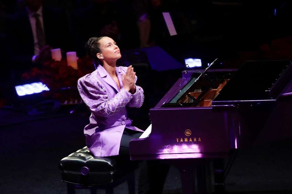 Alicia Keys reacts after performing during a celebration