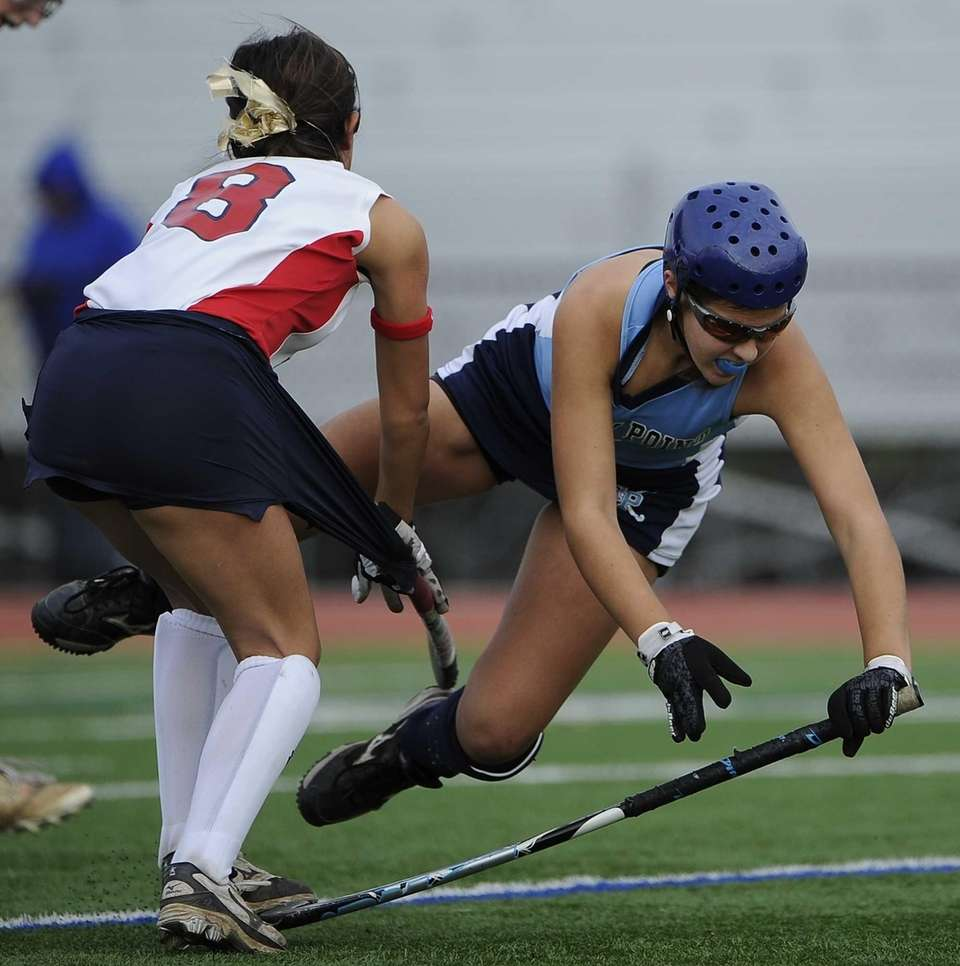 Rocky Point's Maggie DeFrank is tripped up defended