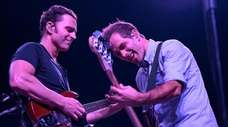 Dweezil Zappa performs with a band member Kurt