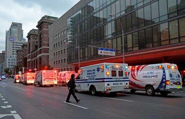 Ambulances line up outside Bellevue Hospital during a