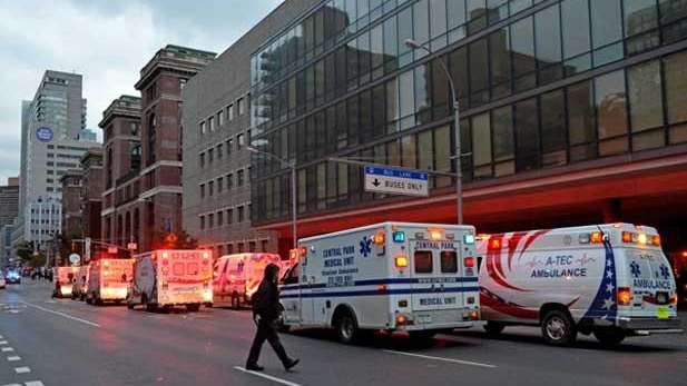 Ambulances line up outside Bellevue Hospital during a