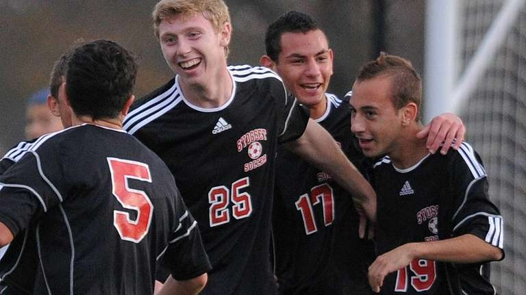 Syosset High School teammates celebrate after a goal