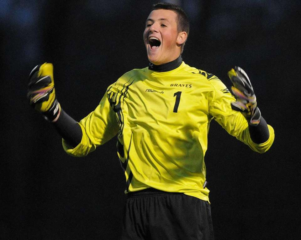 Syosset High School goalie Josh Haberman reacts as