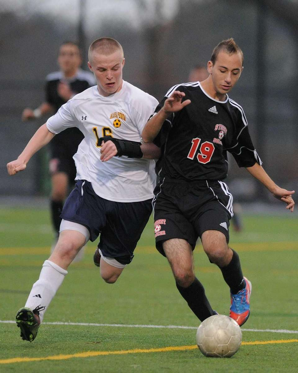 Syosset's Shane Mandel, right, gets pressured by Massapequa's