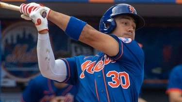 Mets outfielder Michael Conforto bats during a spring