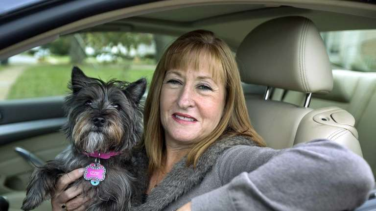 Diane Spitaliere and her pet dog Izzie sit