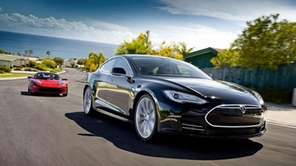 A Model S Alpha and Roadster on the