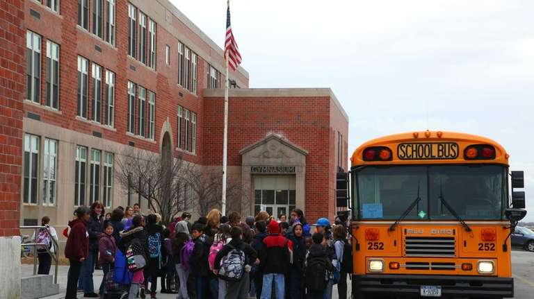 Students arrive at Lindell Elementary School for the