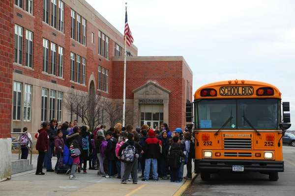 Student arrive Tuesday at Lindell Elementary School in