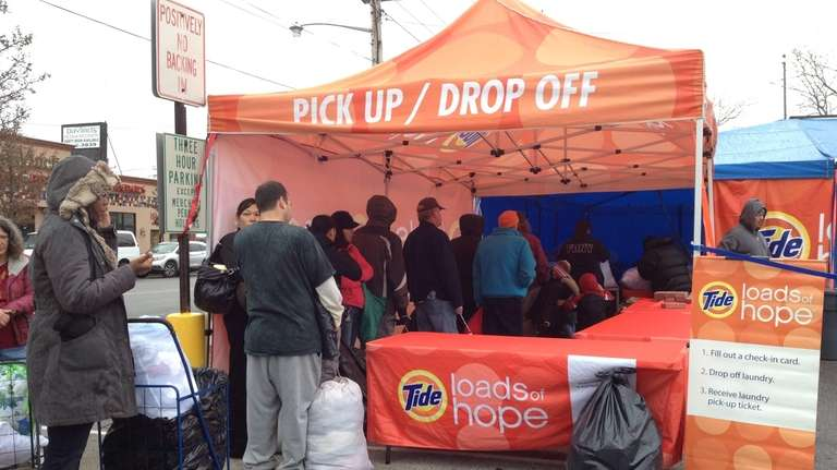 Residents line up to drop off laundry for
