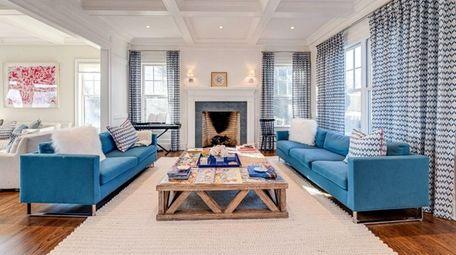 This renovated four-bedroom, 4½-bath farmhouse in Bridgehampton is