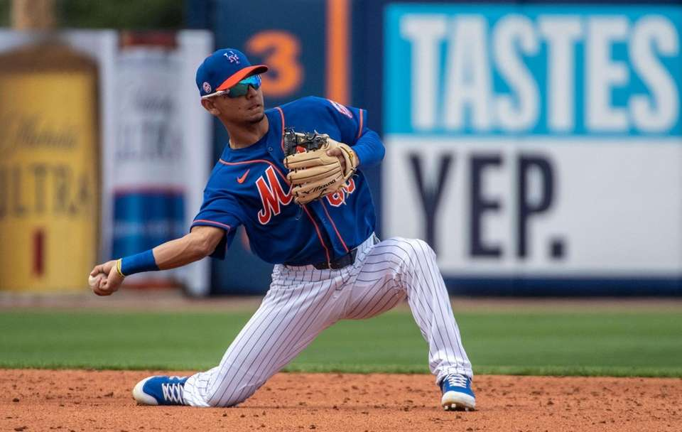 New York Mets' Andres Gimenez throws during today's