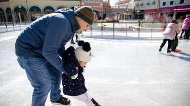 Adam Zacek with 3-year-old daughter, Katiya, at the