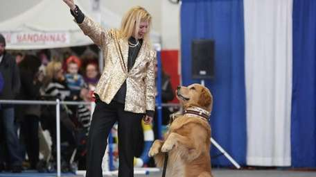 Diane Frohman and her dog, Eddie, perform during