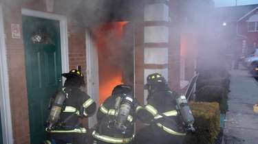 Firefighters battle the blaze Tuesday morning at Bunt