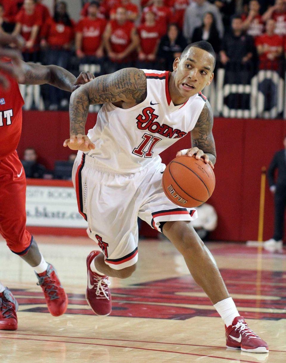 D'Angelo Harrison makes a move toward the basket
