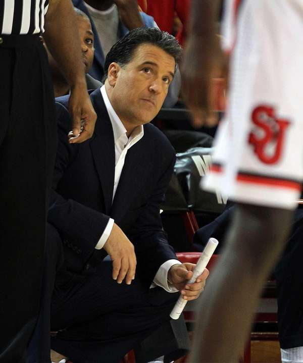 Steve Lavin talks to his players during St.