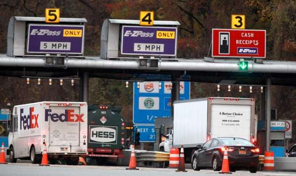 Trucks head northbound on I-87 after a toll