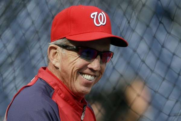 Washington Nationals manager Davey Johnson watches his players