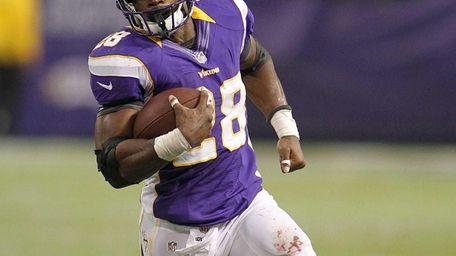 Minnesota Vikings running back Adrian Peterson runs during