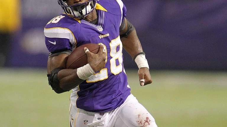 Minnesota Vikings running back Adrian Peterson runs during