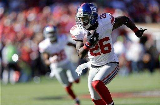 Antrel Rolle runs with the ball during a