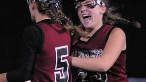 Southampton's Caroline Ricca, right, congratulates Meggie Gallo after