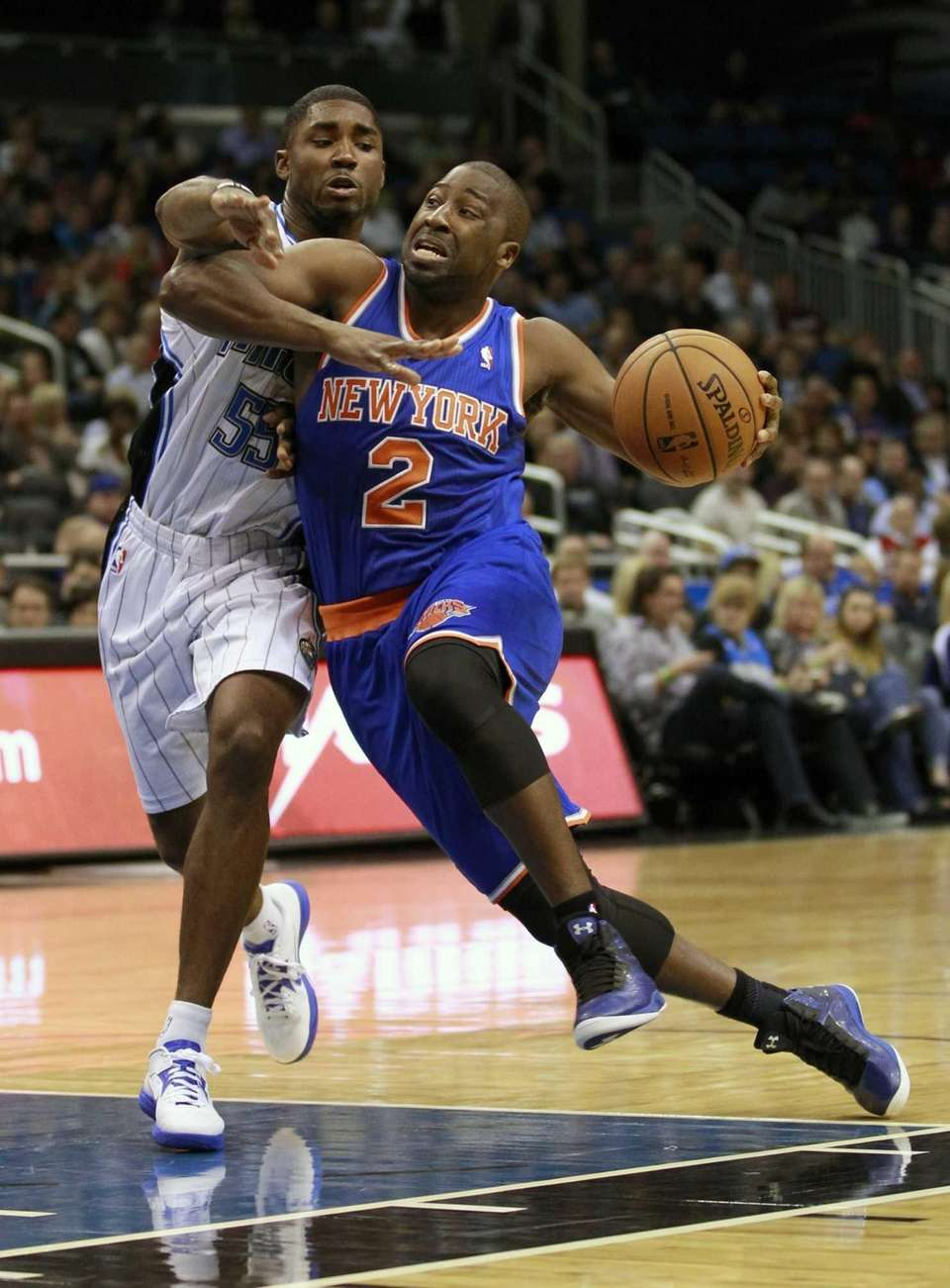 Raymond Felton (2) drives past the Orlando Magic's