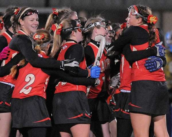 Sachem East teammates celebrate after their 3-0 win