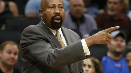 Mike Woodson directs his team during a game