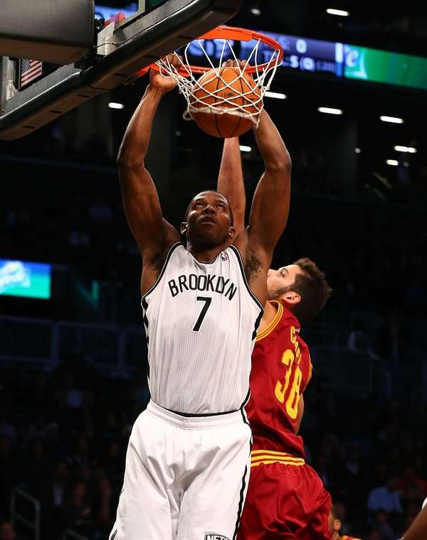Joe Johnson dunks the ball in front of